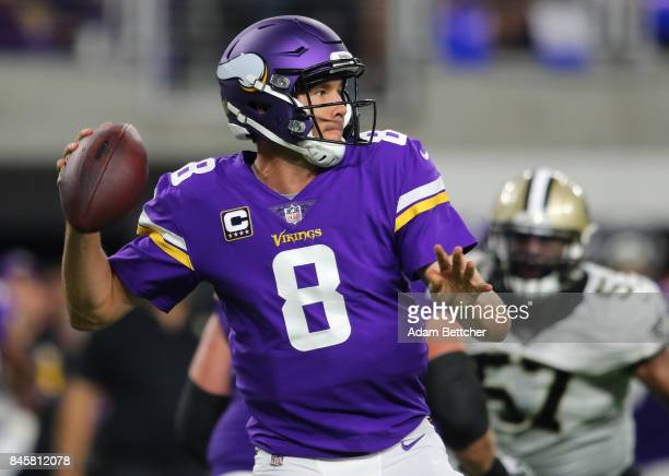 Sam Bradford of the Minnesota Vikings drops back to pass the ball in the third quarter of the game against the New Orleans Saints on September 11...