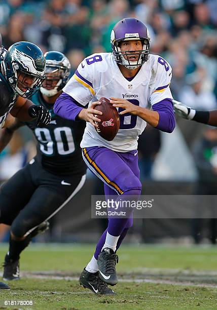 Sam Bradford of the Minnesota Vikings makes a pass as Destiny Vaeao and Marcus Smith II of the Philadelphia Eagles defend during the fourth quarter...