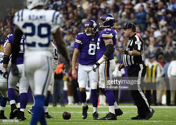 Sam Bradford of the Minnesota Vikings on field with teammate Alex Boone during the second half of the game against the Indianapolis Colts on December...