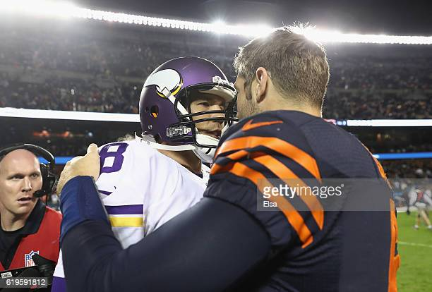 Sam Bradford of the Minnesota Vikings talks to Jay Cutler of the Chicago Bears after the Chicago Bears defeated the Minnesota Vikings 2010 at Soldier...