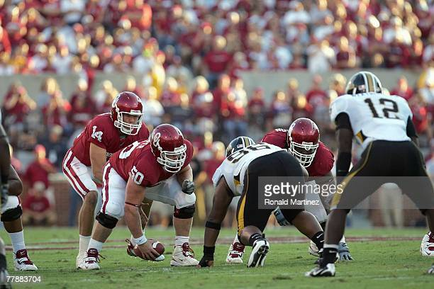 Sam Bradford of the Oklahoma Sooners calls the play during a game against the Missouri Tigers at Memorial Stadium on October 13 2007 in Norman...