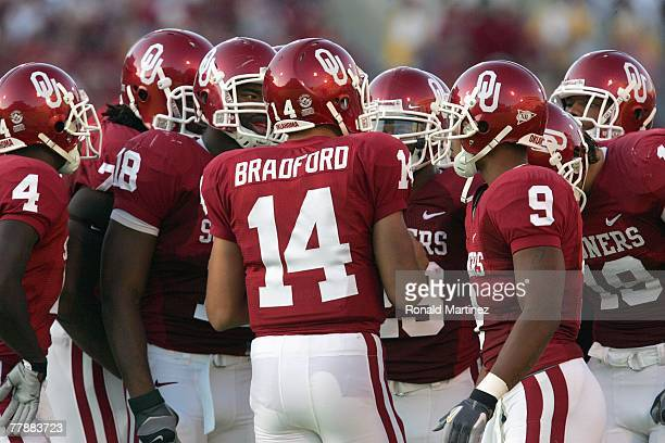 Sam Bradford of the Oklahoma Sooners leads the huddle during a game against the Missouri Tigers at Memorial Stadium on October 13 2007 in Norman...