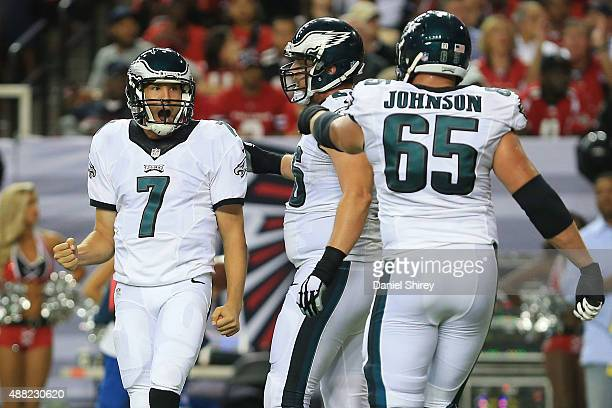 Sam Bradford of the Philadelphia Eagles celebrates throwing a touchdown pass with Andrew Gardner and Lane Johnson during the second half against the...