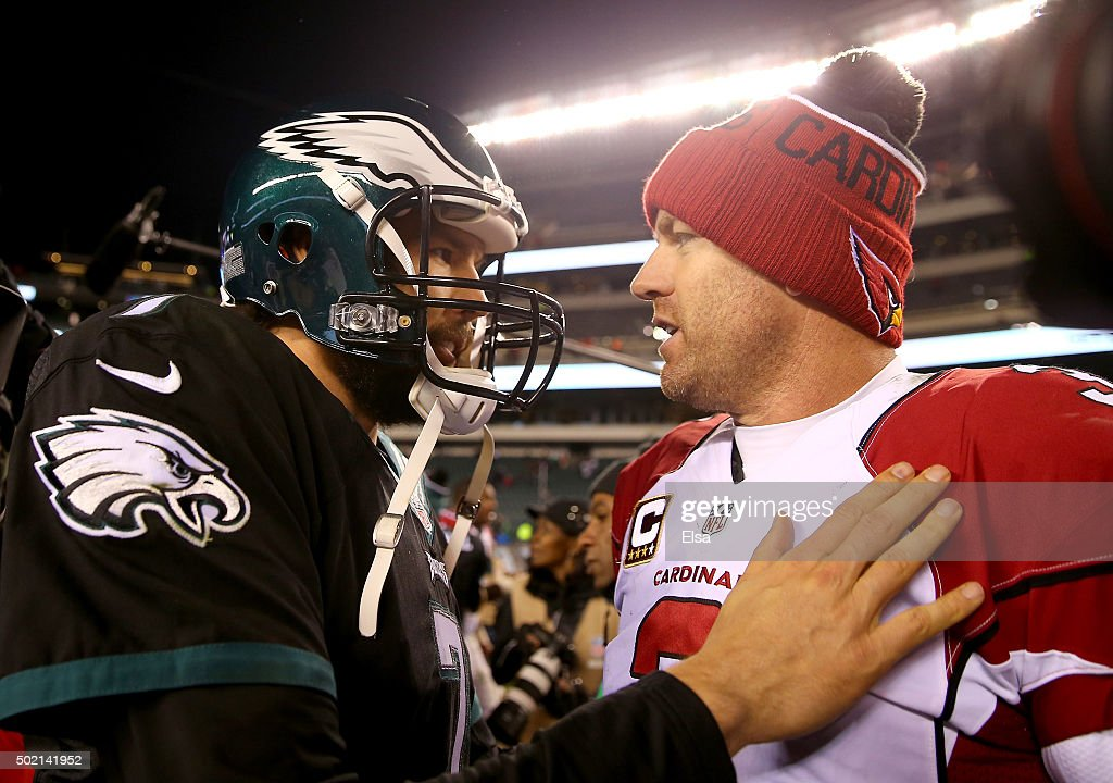 Sam Bradford #7 of the Philadelphia Eagles congratulates Carson Palmer #3 of the Arizona Cardinals after the game at Lincoln Financial Field on December 20, 2015 in Philadelphia, Pennsylvania.The Arizona Cardinals defeated the Philadelphia Eagles 40-17.
