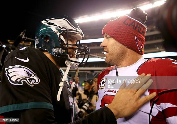 Sam Bradford of the Philadelphia Eagles congratulates Carson Palmer of the Arizona Cardinals after the game at Lincoln Financial Field on December 20...