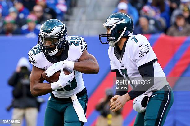 Sam Bradford of the Philadelphia Eagles hands the ball off to DeMarco Murray against the New York Giants during their game at MetLife Stadium on...