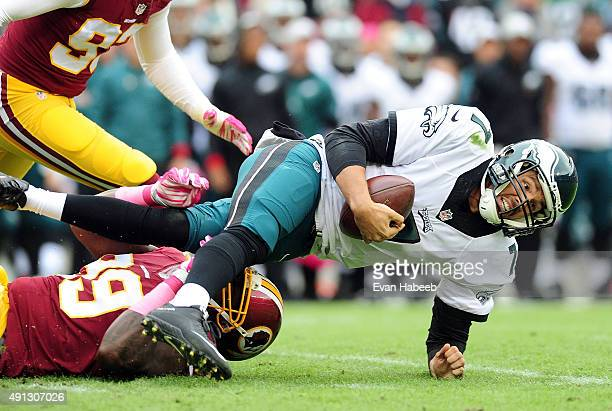 Sam Bradford of the Philadelphia Eagles is tackled by Ricky Jean Francois of the Washington Redskins in the second quarter at FedExField on October 4...