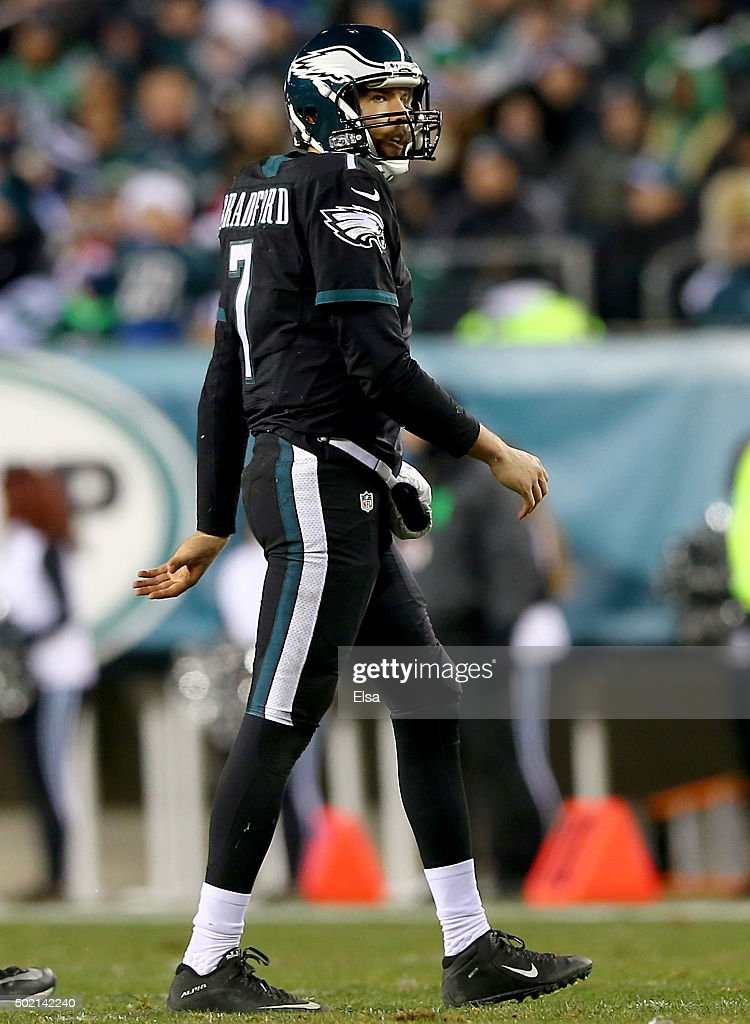Sam Bradford #7 of the Philadelphia Eagles walks off the field after he fumbled the ball as he was sacked in the third quarter against the Arizona Cardinals at Lincoln Financial Field on December 20, 2015 in Philadelphia, Pennsylvania.