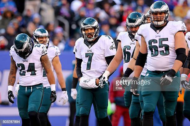 Sam Bradford of the Philadelphia Eagles walks on the field with his teammates against the New York Giants during their game at MetLife Stadium on...