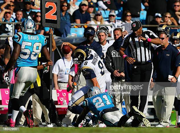 CHARLOTTE NC OCTOBER Sam Bradford of the St Louis Rams is injured as he is knocked out of bounds by Mike Mitchell of the Carolina Panthers during...