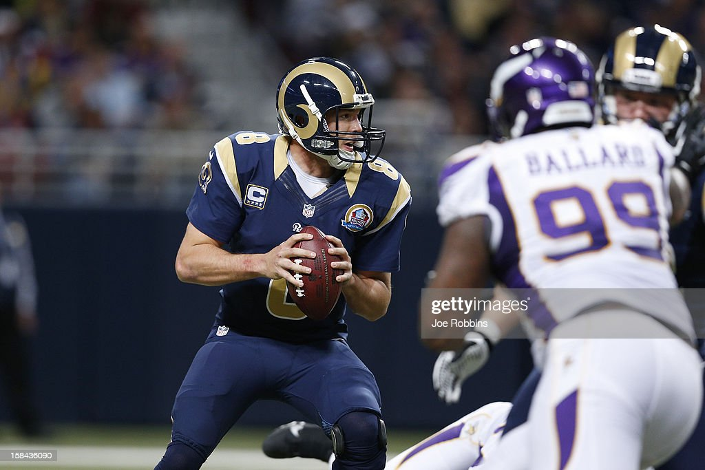 Sam Bradford #8 of the St. Louis Rams looks to pass the ball against the Minnesota Vikings during the game at Edward Jones Dome on December 16, 2012 in St. Louis, Missouri. The Vikings won 36-22.