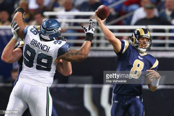 Sam Bradford of the St Louis Rams passes against Alan Branch of the Seattle Seahawks at the Edward Jones Dome on November 20 2011 in St Louis...