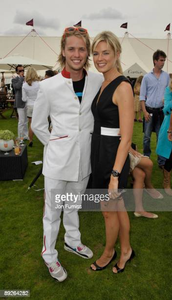 Sam Branson and Isabella AnstrutherGoughCalthorpe pose at the Cartier Tent during the Cartier International Polo Day at Guards Polo Club on July 26...