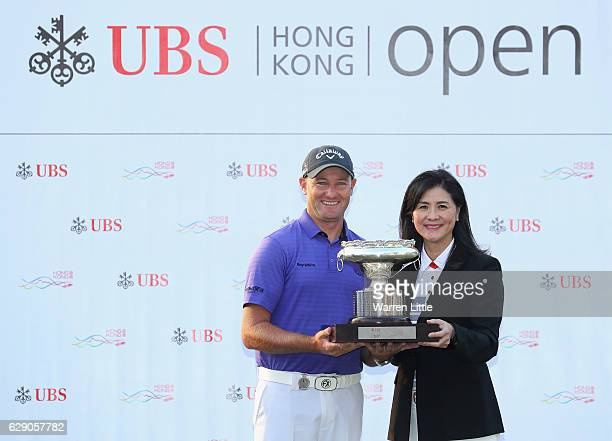 Sam Brazel of Australia is awared the trophy by Amy Lo Head of Greater China UBS after winning the UBS Hong Kong Open at The Hong Kong Golf Club on...