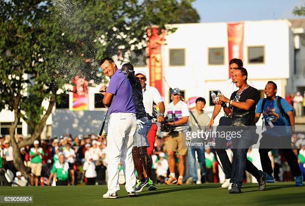 Sam Brazel of Australia is sprayed with champagne after winning the UBS Hong Kong Open at The Hong Kong Golf Club on December 11 2016 in Hong Kong...