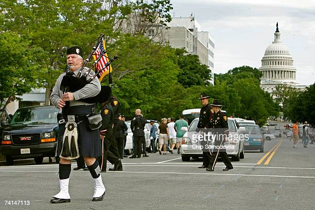 Sam Britton of the Monmouth New Jersey County Police Pipes and Drums practices before marching with hundreds of law enforcement bagpipe players and...