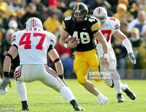 Sam Brownlee of of Iowa attempts to elude AJ Hawk of Ohio State October 16 2004 at Kinnick Stadium in Iowa City Iowa