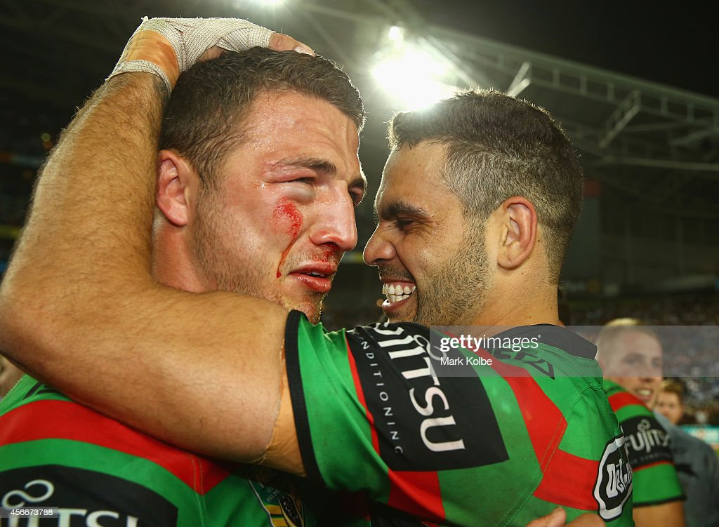Sam Burgess and Greg Inglis of the Rabbitohs celebrate victory during the 2014 NRL Grand Final match between the South Sydney Rabbitohs and the Canterbury Bulldogs at ANZ Stadium on October 5, 2014 in Sydney, Australia.