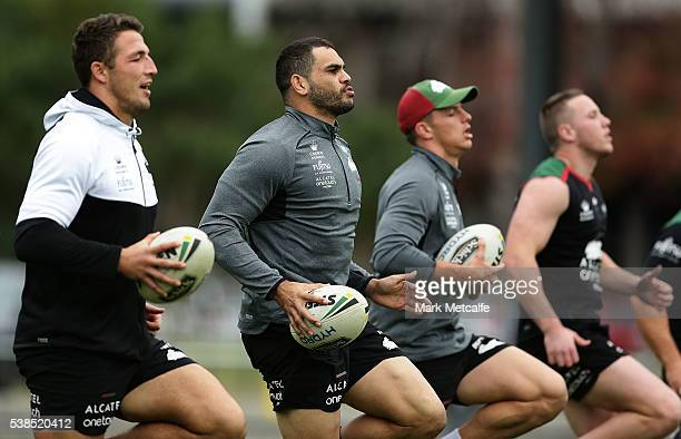Sam Burgess and Greg Inglis warm up during a South Sydney Rabbitohs training session at Redfern Oval on June 7 2016 in Sydney Australia