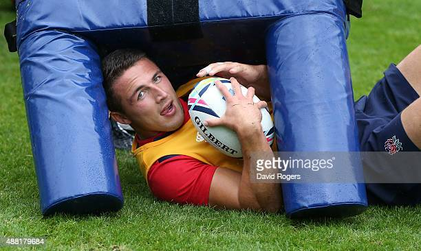 Sam Burgess ends up underneath a tackle bag during the England training session at Pennyhill Park on September 14 2015 in Bagshot England