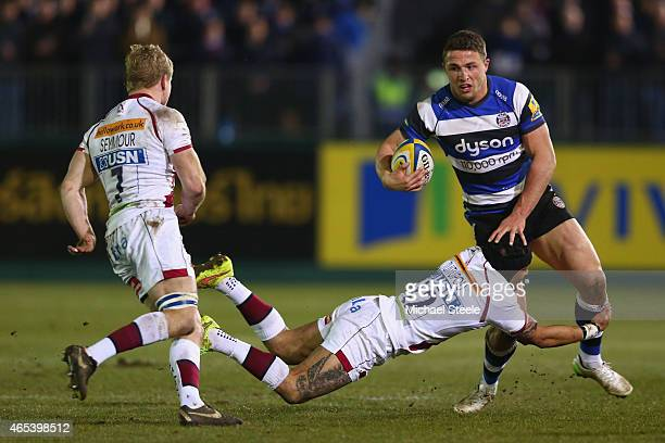 Sam Burgess of Bath is held up by Sam Tuitupou of Sale during the Aviva Premiership match between Bath Rugby and Sale at the Recreation Ground on...