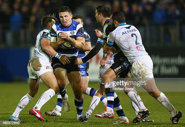 Sam Burgess of Bath is held up by Wynand Olivier of Montpellier during the European Rugby Champions Cup Pool Four match between Bath Rugby and...