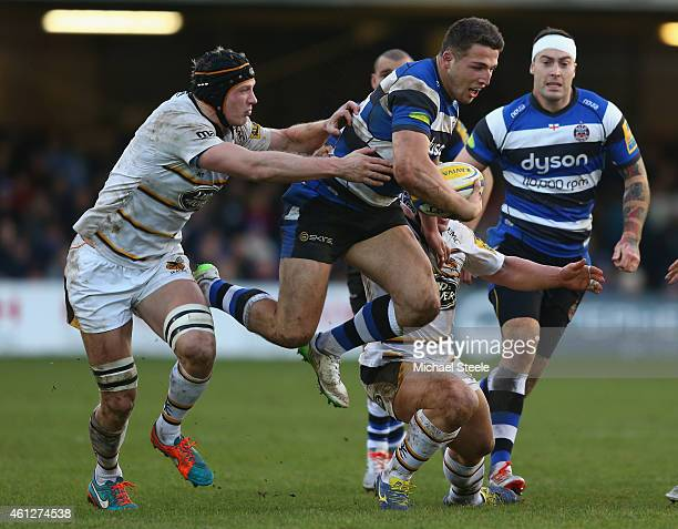Sam Burgess of Bath powers his way through the challenge of Kearman Myall of Wasps during the Aviva Premiership match between Bath Rugby and Wasps at...