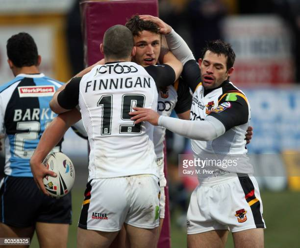 Sam Burgess of Bradford Bulls is congratulated by Simon Finnigan and his team mates after scoring a try during the engage Super League match between...