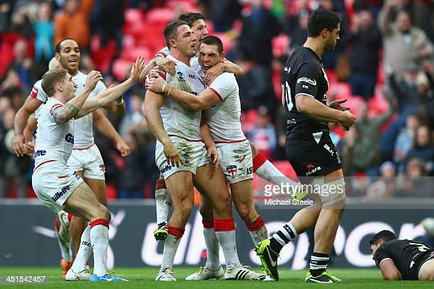 Sam Burgess of England celebrates scoring his sides third try during the Rugby League World Cup Semi Final match between New Zealand and England at...