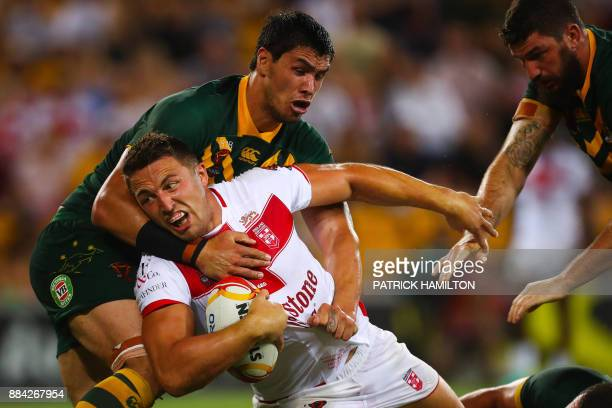Sam Burgess of England is tackled by Jordan McLean of Australia during the rugby league World Cup men's final match between Australia and England in...