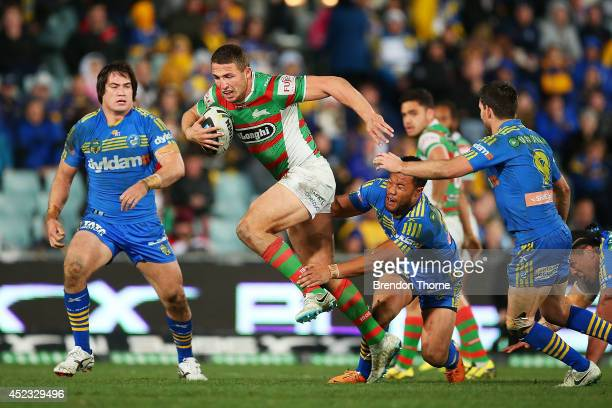 Sam Burgess of the Rabbitohs breaks the Eels defence during the round 19 NRL match between the Parramatta Eels and the South Sydney Rabbitohs at...
