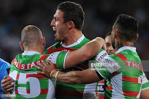 Sam Burgess of the Rabbitohs celebrates a try during the round 20 NRL match between the Gold Coast Titans and the South Sydney Rabbitohs at Skilled...