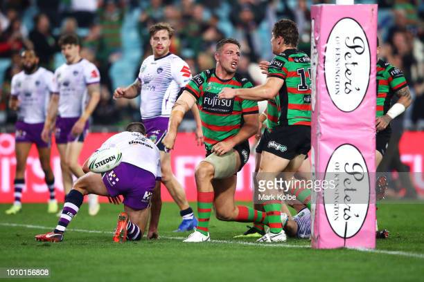 Sam Burgess of the Rabbitohs celebrates scoring a try during the round 21 NRL match between the South Sydney Rabbitohs and the Melbourne Storm at ANZ...