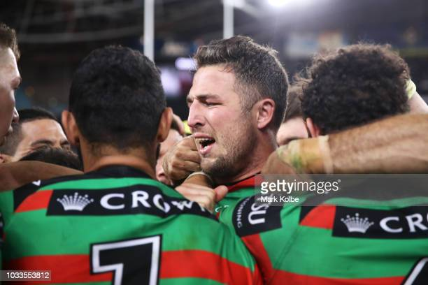 Sam Burgess of the Rabbitohs celebrates victory with his team mates during the NRL Semi Final match between the South Sydney Rabbitohs and the St...