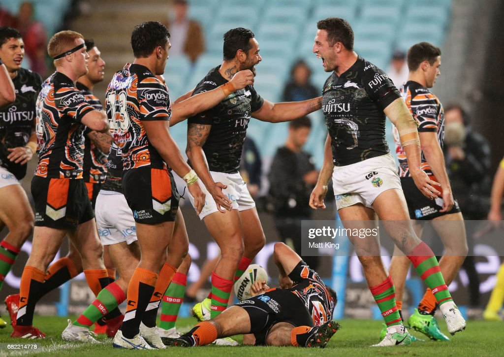 Sam Burgess of the Rabbitohs celebrates with team mates after scoring a try during the round ten NRL match between the Wests Tigers and the South Sydney Rabbitohs at ANZ Stadium on May 12, 2017 in Sydney, Australia.