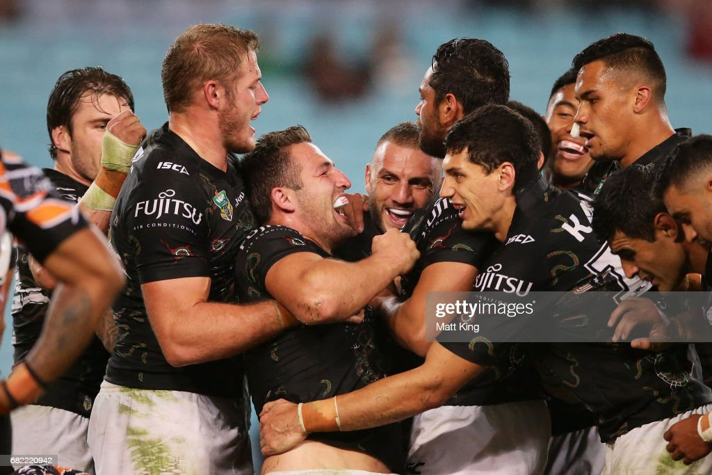 Sam Burgess of the Rabbitohs celebrates with team mates after scoring his second try during the round ten NRL match between the Wests Tigers and the South Sydney Rabbitohs at ANZ Stadium on May 12, 2017 in Sydney, Australia.