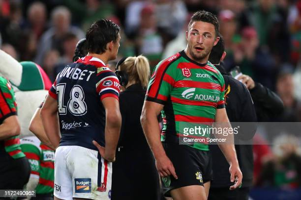 Sam Burgess of the Rabbitohs exchanges words with Billy Smith of the Roosters during the round 25 NRL match between the South Sydney Rabbitohs and...