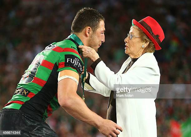 Sam Burgess of the Rabbitohs is presented with the Clive Churchill medal by Joyce Churchill after the 2014 NRL Grand Final match between the South...