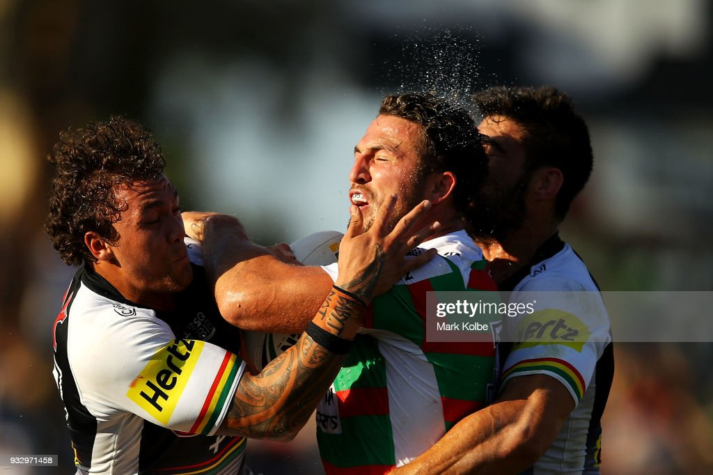 Sam Burgess of the Rabbitohs is tackled by James Fisher-Harris and James Tamou of the Panthers during the round two NRL match between the Penrith Panthers and the South Sydney Rabbitohs at Penrith Stadium on March 17, 2018 in Sydney, Australia.