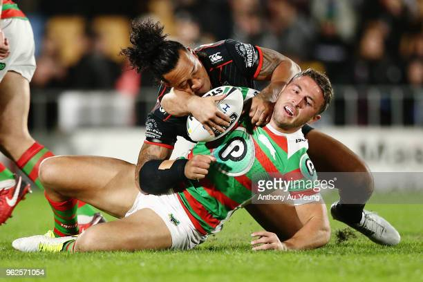 Sam Burgess of the Rabbitohs is tackled by James Gavet of the Warriors during the round 12 NRL match between the New Zealand Warriors and the South...