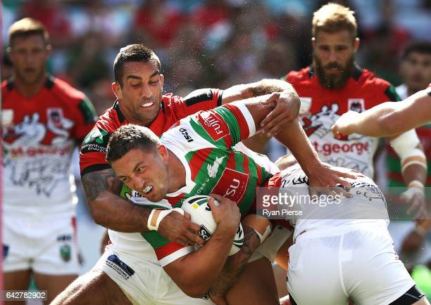 Sam Burgess of the Rabbitohs is tackled by Paul Vaughan of the Dragons during the NRL Charity Shield match between the South Sydney Rabbitohs and the...