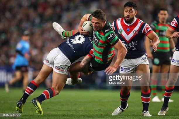 Sam Burgess of the Rabbitohs is tackled during the NRL Preliminary Final match between the Sydney Roosters and the South Sydney Rabbitohs at Allianz...