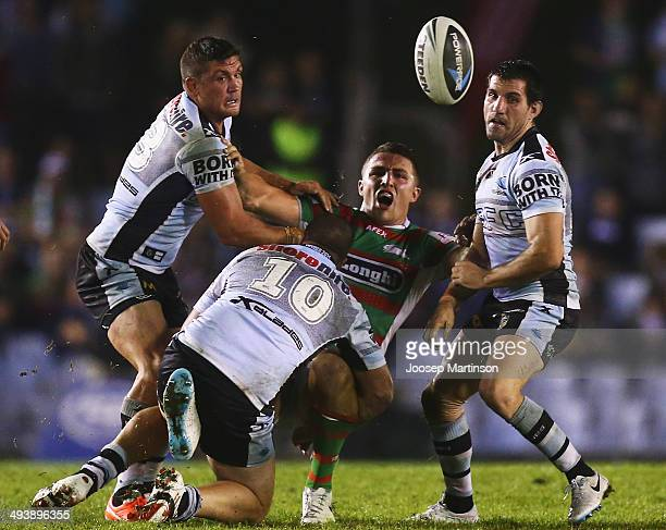 Sam Burgess of the Rabbitohs is tackled during the round 11 NRL match between the Cronulla-Sutherland Sharks and the South Sydney Rabbitohs at...