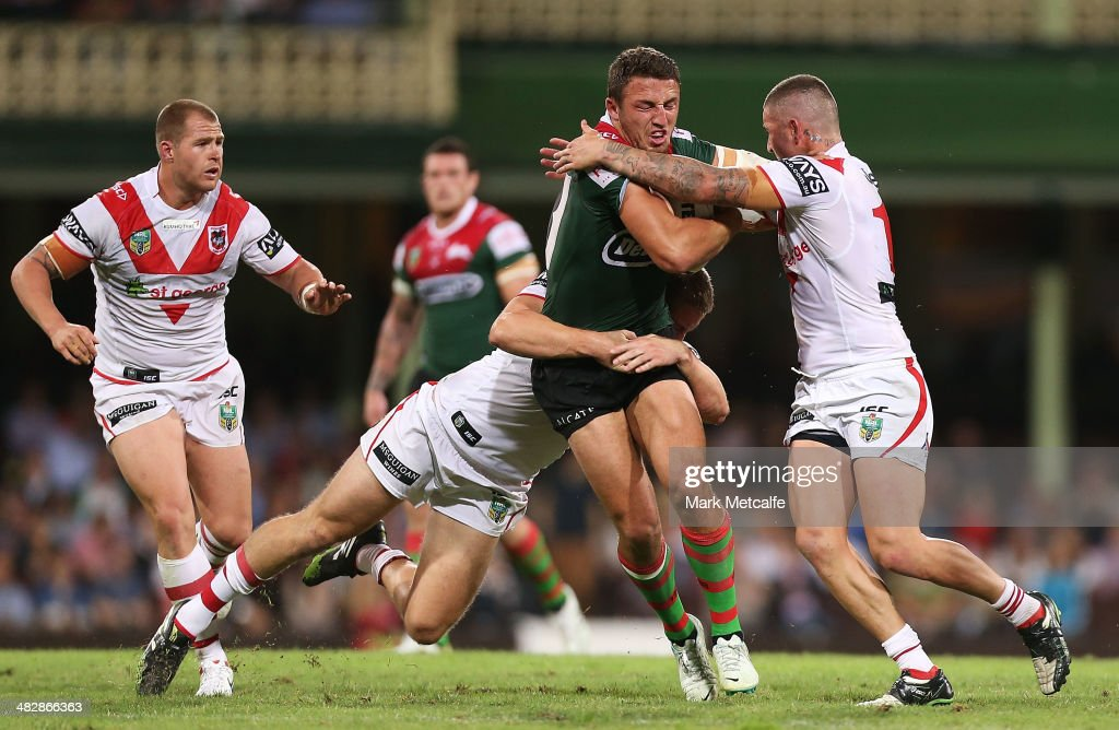 Sam Burgess of the Rabbitohs is tackled during the round five NRL match between the St George Illawarra Dragons and the South Sydney Rabbitohs at Sydney Cricket Ground on April 5, 2014 in Sydney, Australia.