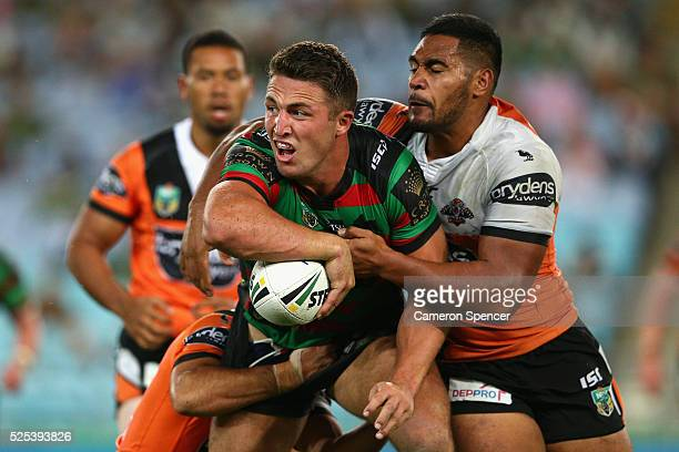 Sam Burgess of the Rabbitohs is tackled during the round nine NRL match between the South Sydney Rabbitohs and the Wests Tigers at ANZ Stadium on...