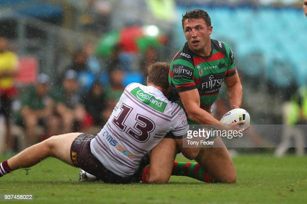 Sam Burgess of the Rabbitohs is tackled during the round three NRL match between the South Sydney Rabbitohs and the Manly Sea Eagles at ANZ Stadium...