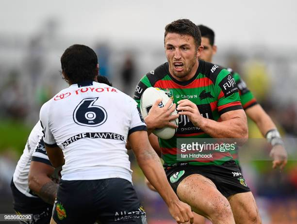 Sam Burgess of the Rabbitohs looks to get past Enari Tuala of the Cowboys during the round 16 NRL match between the South Sydney Rabbitohs and the...