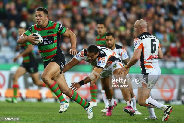 Sam Burgess of the Rabbitohs makes a break during the round 10 NRL match between the South Sydney Rabbitohs and the Wests Tigers at ANZ Stadium on...