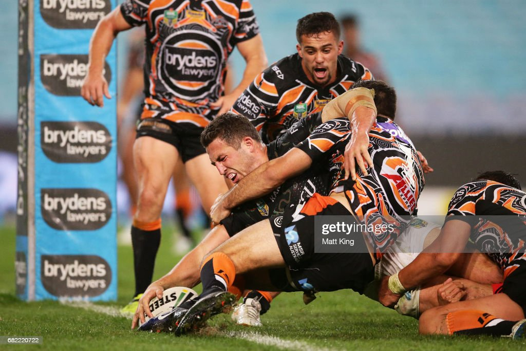 Sam Burgess of the Rabbitohs reaches out to score his second try during the round ten NRL match between the Wests Tigers and the South Sydney Rabbitohs at ANZ Stadium on May 12, 2017 in Sydney, Australia.