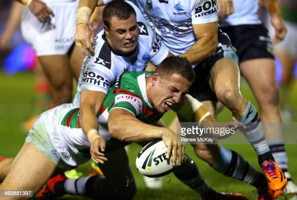 Sam Burgess of the Rabbitohs scores a try during the round 11 NRL match between the Cronulla-Sutherland Sharks and the South Sydney Rabbitohs at...